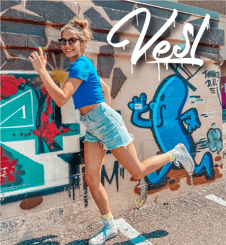 woman blue t-shirt on a graffiti background