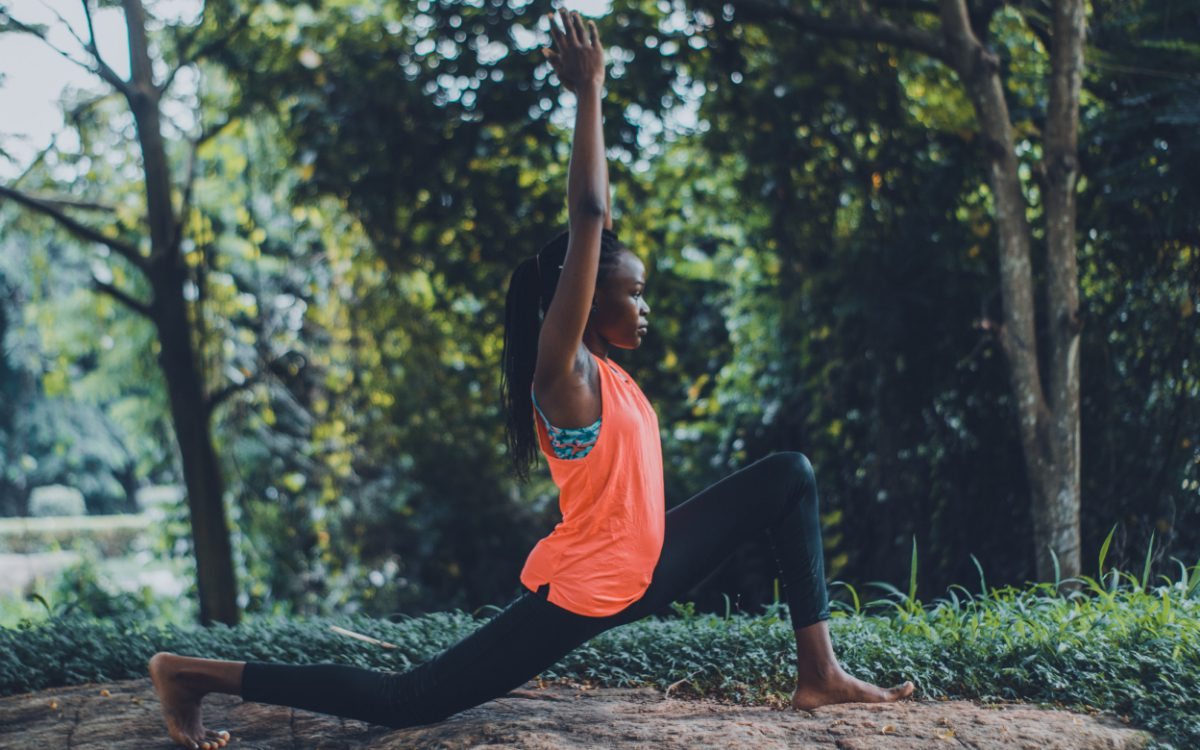 Woman practicing outdoor yoga. Holistic lifestyle