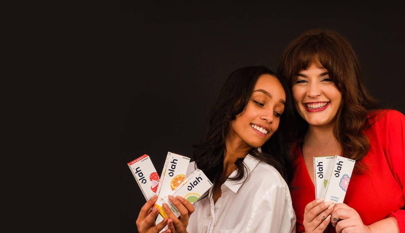 Women holding all flavors of CBD Vaporizes
