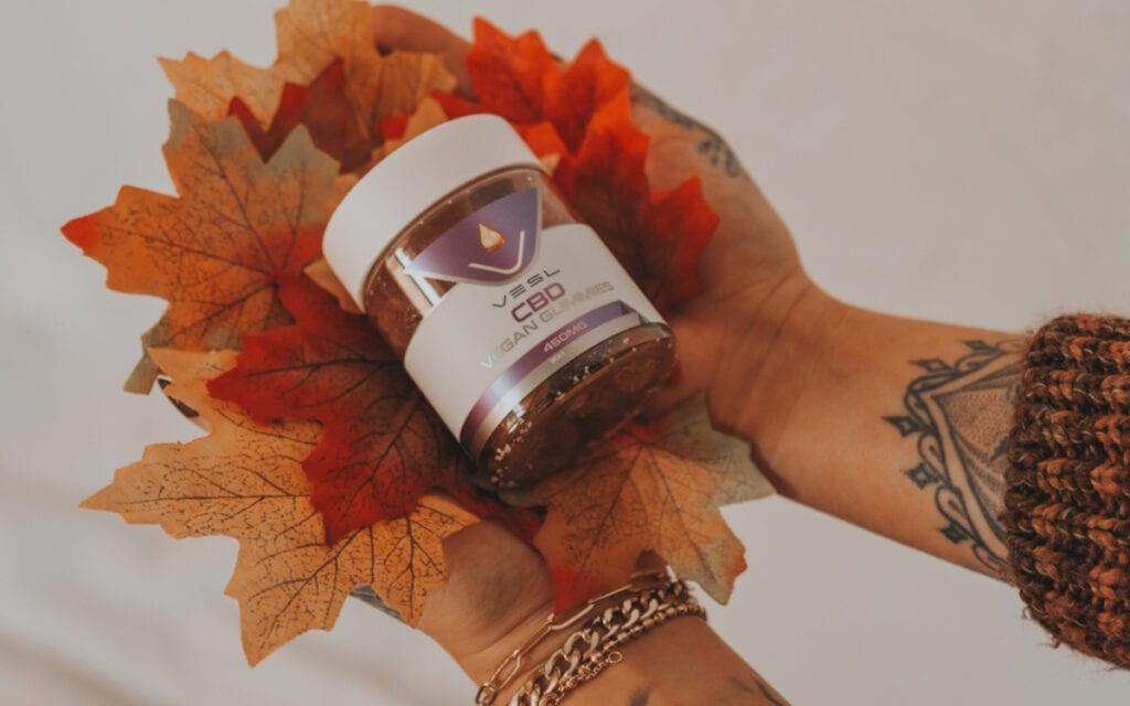 Vesl oils product. A person holding a CBD Vegan Gummies